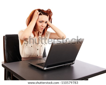 Stressed caucasian redhead woman at her computer