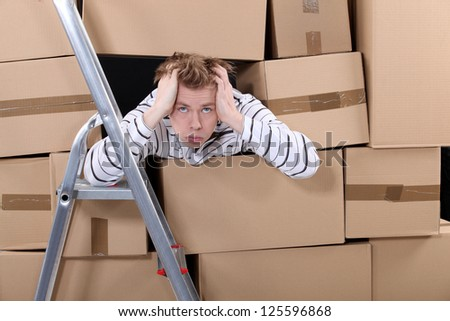 Stressed factory worker - stock photo