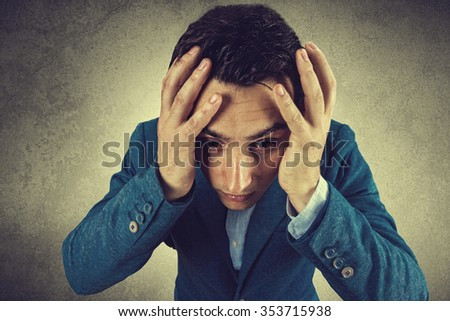 Stressed,frustrated,depressed portrait of a young student, man, holding his hands up on head isolated on grey background.Facial expression, - stock photo