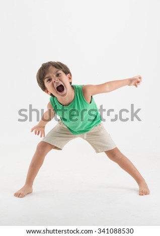 Stressed little boy looking furious - stock photo