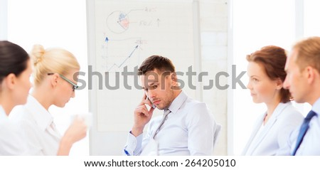 stressed male boss on business meeting with team in office - stock photo