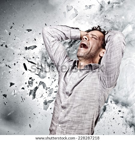 stressed man and background explosion - stock photo