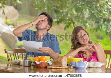 Stressed man and woman arguing about family budget - stock photo