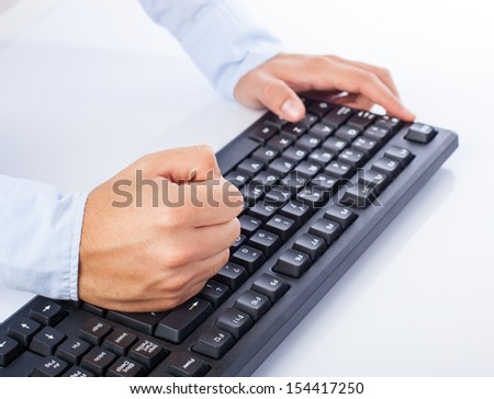 stressed man at computer on a white background