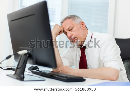 Stressed man in front of his computer