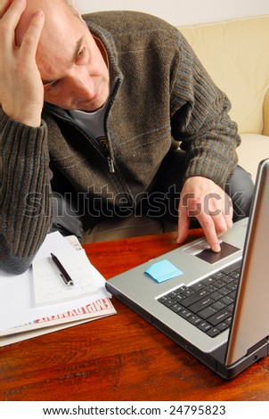 Stressed man is looking on-line for a job - stock photo