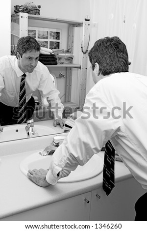 stressed man looking in mirror