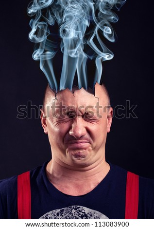 Stressed man with exploded head - stock photo