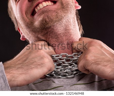 Stressed man with iron chain around neck - stock photo