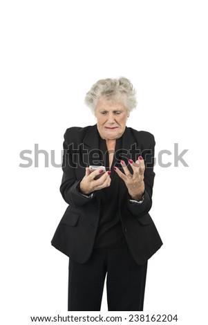 Stressed old woman holding her mobile phone against a white background