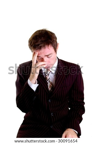stressed out business man with hand on head - stock photo