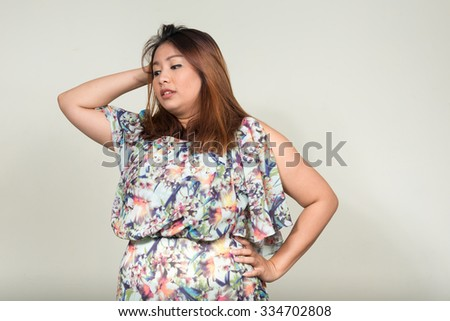 Stressed overweight woman - stock photo