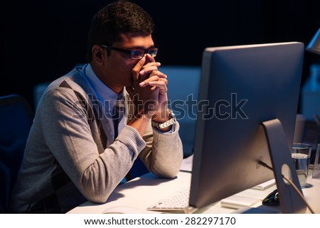 Stressed overworked Indian businessman looking at the computer screen - stock photo