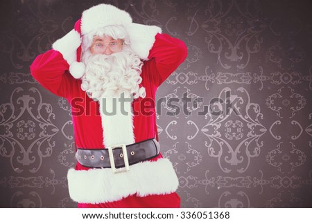 Stressed santa with his hands on head against elegant patterned wallpaper in grey - stock photo
