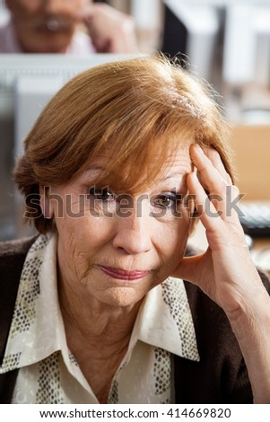 Stressed Senior Woman In Computer Class - stock photo