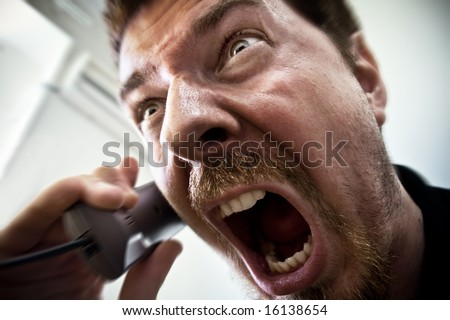 Stressed Stock Broker Screaming on the Phone - stock photo