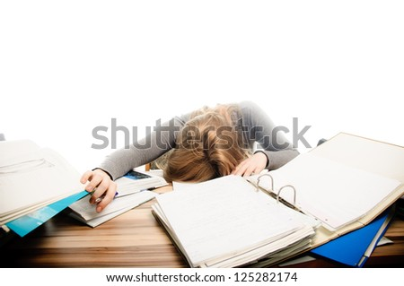 Stressed student revising for an exam - isolated on white backgrground