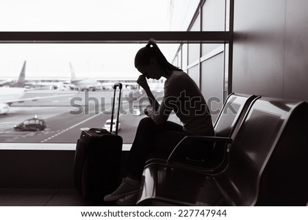 Stressed woman at the airport - stock photo