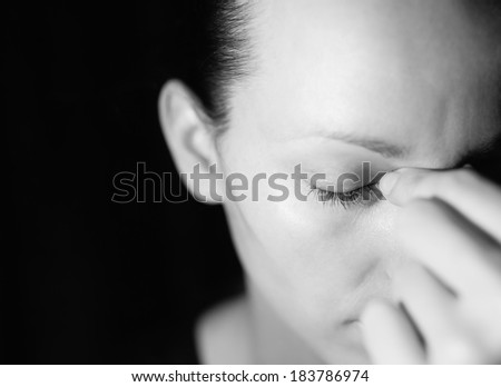 Stressed woman (black and white portrait). - stock photo