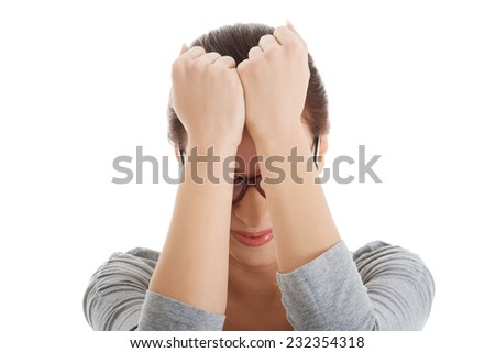 Stressed woman holding hands to head. - stock photo