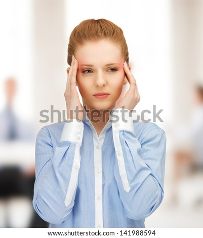 stressed woman holding her head with hands - stock photo