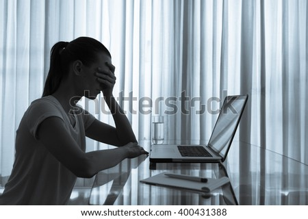 Stressed woman in her office. - stock photo