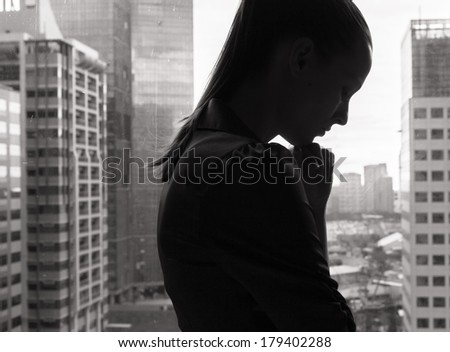 Stressed woman in the office. - stock photo