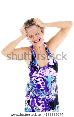 Stressed woman pulling hair, over white background.   - stock photo