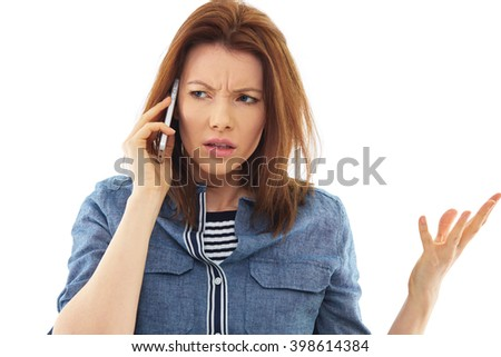 Stressed woman talks over her mobile phone, isolated over white background - stock photo