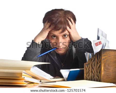 Stressed woman working on taxes and household finances - stock photo