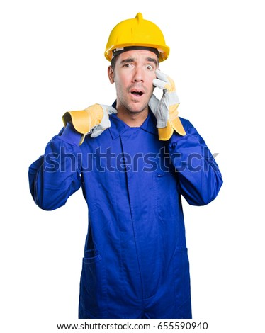 Stressed workman on white background