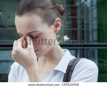 Stressed young business woman. - stock photo