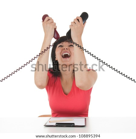 stressed young businesswoman with telephones in her hands, white background - stock photo