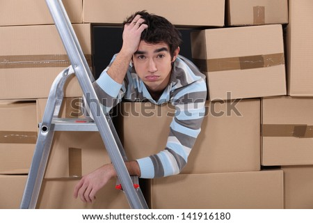 Stressed young factory worker - stock photo