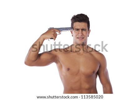 Stressed young man with a gun pointing to his head (isolated on white) - stock photo
