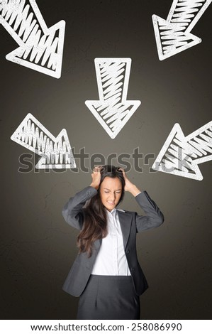 Stressed Young Office Woman with Conceptual White Arrows Above Pointing Her on Abstract Gray Gradient Background.