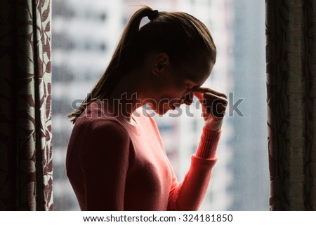 Stressed young woman in the city - stock photo