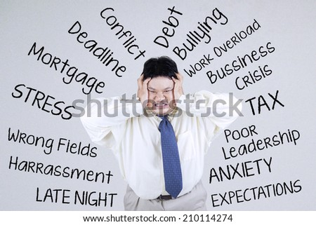Stressful an obesity businessman having many problem - stock photo