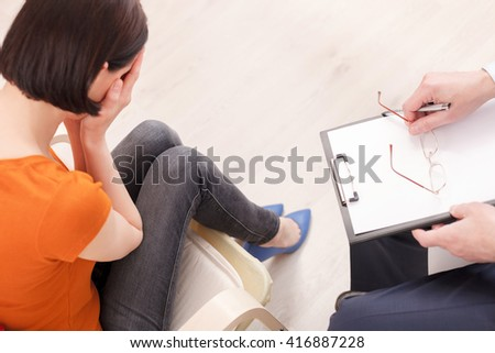 Stressful lady is visiting a psychotherapist - stock photo