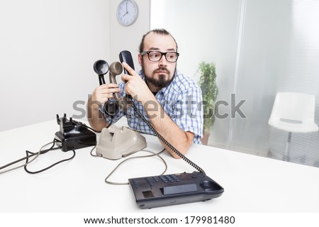 Stressful work with many telephones - stock photo