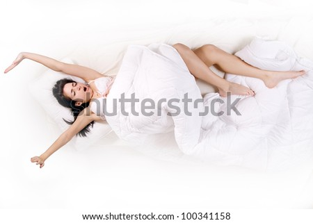 stretch girl in bed - stock photo