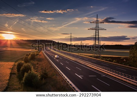 stretch of motorway in Germany by setting sun - stock photo