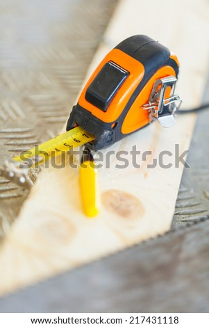 Stretched Measuring Tape - stock photo