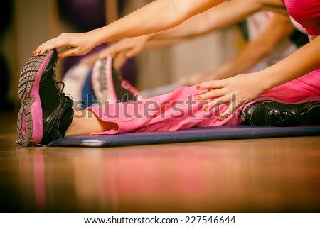 stretching pilate exercises in fitness studio - stock photo