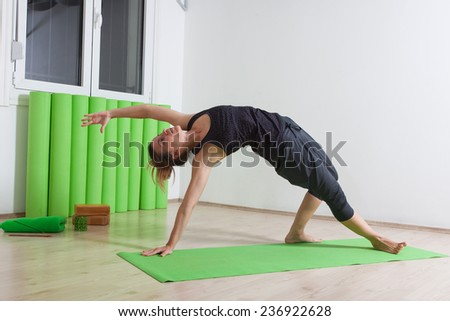 stretching while doing yoga - stock photo