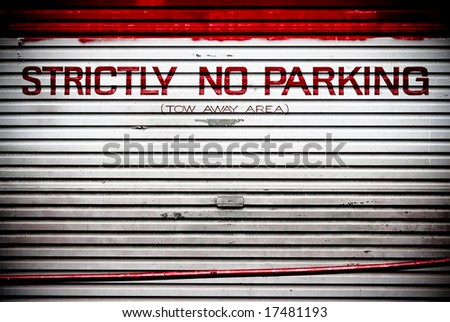 strictly no parking painter on roller door