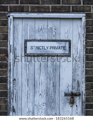 Strictly private locked door with padlock