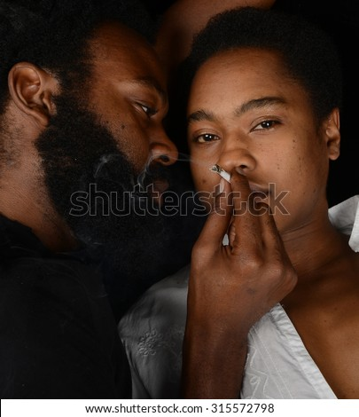 Striking Image of a Woman getting High from Weed and her dealer - stock photo