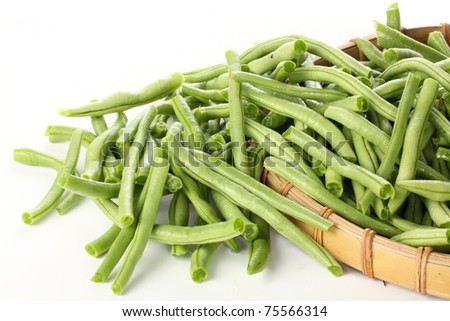 string beans in a Bamboo basket - stock photo