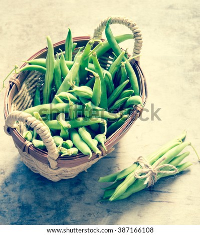 String beans in basket/toned photo - stock photo